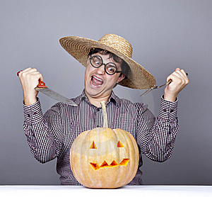 Funny Men Try To Eat A Pumpkin. Stock Photo - Image: 16752850