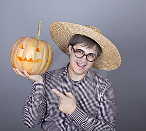 Funny Men Try To Eat A Pumpkin. Stock Photography - Image: 16752882