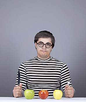Funny Boy Try To Eat Apples. Royalty Free Stock Image - Image: 16755806