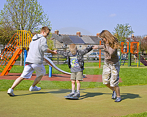 A Young Family Play Together Royalty Free Stock Photography - Image: 16762697