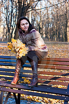 Beautiful Young Woman On A Bench Stock Image - Image: 16765701