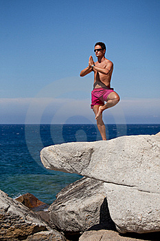 Man Meditating On A Rocky Beach Royalty Free Stock Photos - Image: 16776058