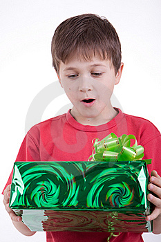 The Boy Has Received A Gift Royalty Free Stock Photo - Image: 16795025