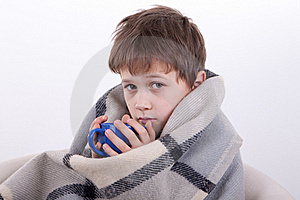 The Boy Covered By A Checkered Plaid, Drinks Royalty Free Stock Images - Image: 16795349