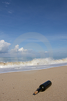 A Bottle On  Beach Stock Images - Image: 16819684