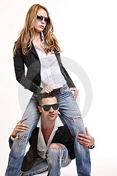 Young Fashion Couple Posing In Studio Royalty Free Stock Photos - Image: 16831818