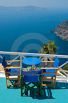 Blue Chairs And Table In Santorini Stock Photo - Image: 16832560
