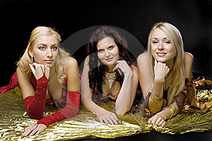 Three Young Woman  On Gold Wing Royalty Free Stock Photo - Image: 16850525