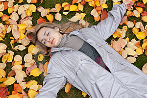 Beautiful Girl Rests Upon Autumn Sheet Stock Photos - Image: 16857283