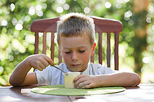 Little Boy Eating Pudding Stock Photos - Image: 16871013