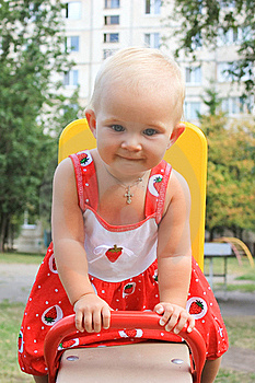Cute Little Girl Swinging In The  Playground Royalty Free Stock Photography - Image: 16875947