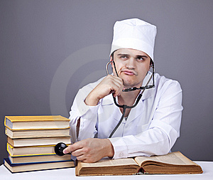 Young Male Doctor Studying Medical Books Stock Images - Image: 16882944