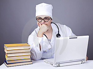Young Doctor With Books And Computer. Royalty Free Stock Image - Image: 16882956