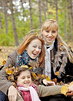 Two Sisters And Mother In The Park. Royalty Free Stock Photos - Image: 16883348