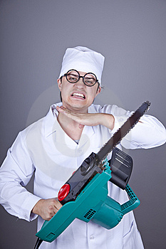 Crazy Doctor With Portable Saw. Stock Photography - Image: 16883562