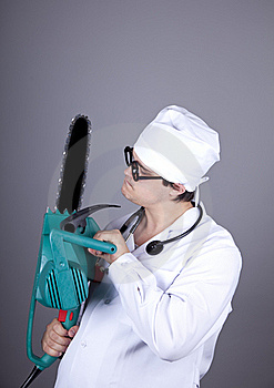 Crazy Doctor With Portable Saw. Stock Photography - Image: 16883582