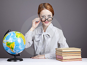 The Young Teacher In Glasses With Books And Globe Stock Images - Image: 16883964