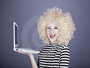 Portrait Of Funny Girl In Blonde Wig With Laptop. Stock Images - Image: 16884584