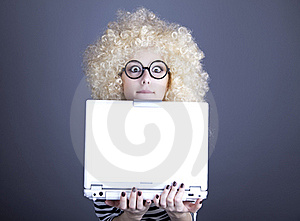 Portrait Of Funny Girl In Blonde Wig With Laptop. Royalty Free Stock Photography - Image: 16884687