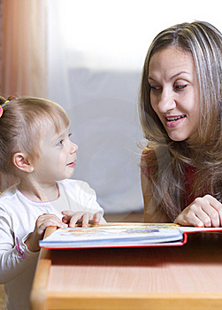 Mother And Daughter Learning At Home Royalty Free Stock Photo - Image: 16919045