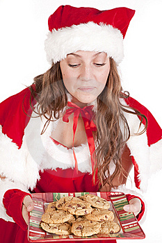 Mrs Santa Smelling Cookies Royalty Free Stock Images - Image: 16930379