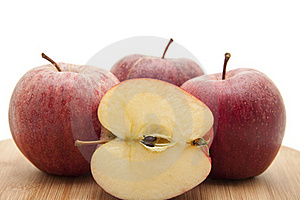 Halved Apple On Edge Board Royalty Free Stock Images - Image: 16943989