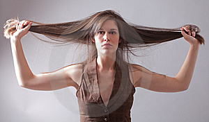 Beautiful Woman Holding Long Hair Out Stock Photography - Image: 16944732