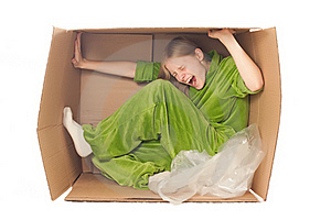 Young Woman Stretch Box By Hands And Legs Stock Photos - Image: 16965033