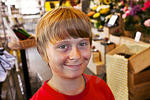Young Boy Smiles In A Shop Royalty Free Stock Photography - Image: 16972017