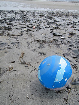 Plastic Blue Ball on Beach Royalty Free Stock Image