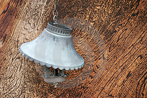 Old Broken Lamp Against Wooden Wall Stock Photography