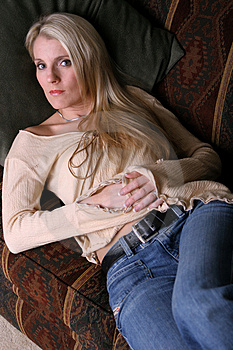Blonde on Couch three Stock Photography