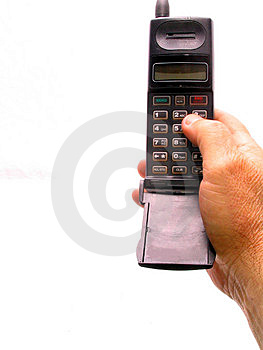 Cell Phone In Hand Over White Free Stock Images
