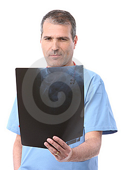 Doctor Looking At A Xray Royalty Free Stock Images - Image: 17001449