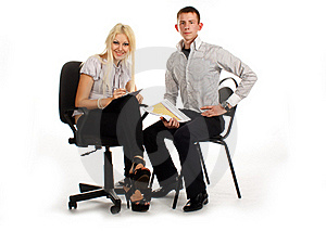 Businesswoman And Man On Office Chair Royalty Free Stock Image - Image: 17010096