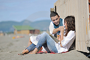 Young Couple Enjoying  Picnic On The Beach Stock Photos - Image: 17021353