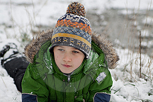 The Boy Lies On Snow Stock Photo - Image: 17103600