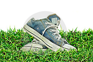 Old, Dirty Sneakers Over Spring Green Grass Royalty Free Stock Photo - Image: 17105175