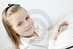 Cute Girl With Laptop Indoors Stock Image - Image: 17124011