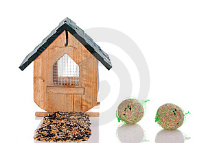 Wooden Birdhouse With Seeds Royalty Free Stock Photography - Image: 17146217
