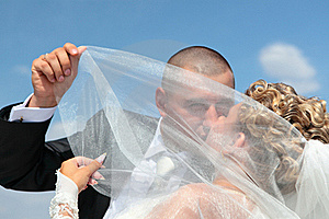 The Groom And The Bride Kiss Under A Veil Stock Photos - Image: 17162903
