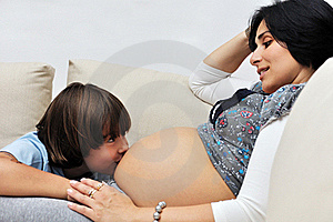 Young Boy Kissing Pregnant Woman Stock Photography - Image: 17187172