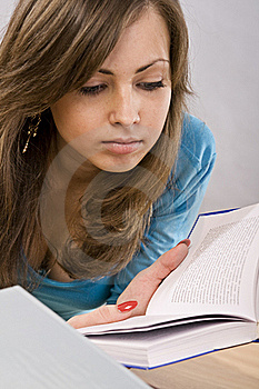Beautiful Girl Thoughtfully Reading A Book Royalty Free Stock Image - Image: 17199606