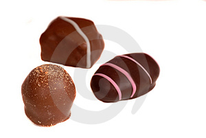 Three Pieces Of Chocolate Isolated On White Royalty Free Stock Photos - Image: 1728468