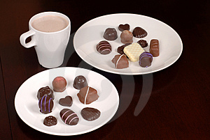 Two Plates Of Chocolates With A Cup Of Hot Chocolate Stock Photos - Image: 1728473
