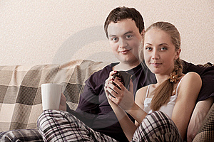 Young Couple On A Couch Stock Photos - Image: 17200413