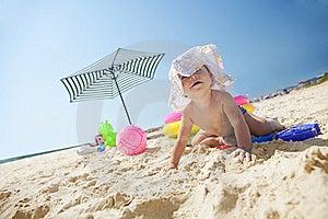 Little Girl On The Sand Beach Royalty Free Stock Photos - Image: 17207428