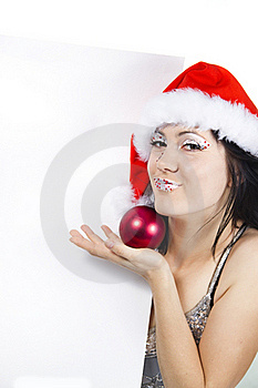Girl In A Santa's Hat With A Tag Stock Photos - Image: 17207713