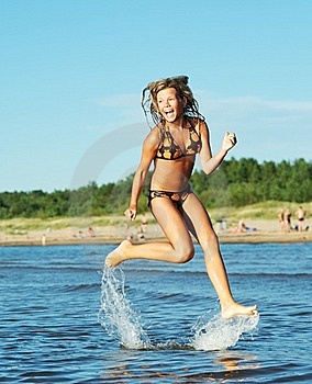 Girl Running In The Sea Royalty Free Stock Images - Image: 17208639