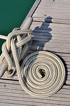 Boat Rope Twist Into Circle On Dock Royalty Free Stock Photography - Image: 17210877